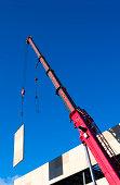 Construction Crane Lifiting Concrete Panel