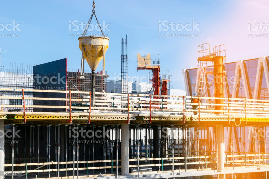 Construction crane tower on blue sky background. Crane and building working progress. Worker. Empty Space for text. Construction concept. Site. New buildings with a crane. Tower crane stock photo
