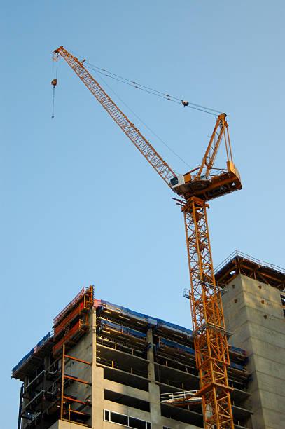 construction crane urban city development stock photo