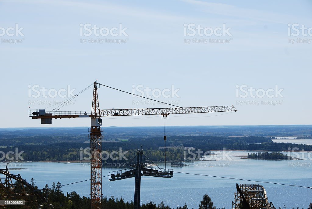 Construction crane with scenic background bildbanksfoto