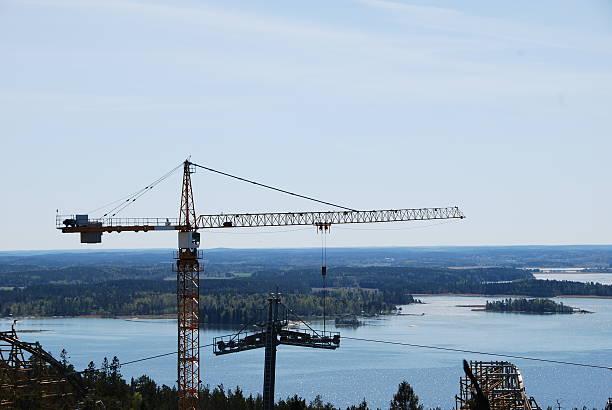 Construction crane with scenic background bildbanksfoto