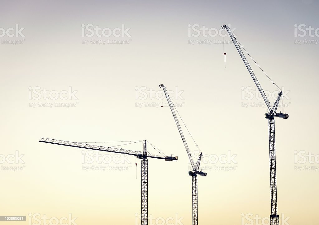 Construction Cranes at Dawn stock photo