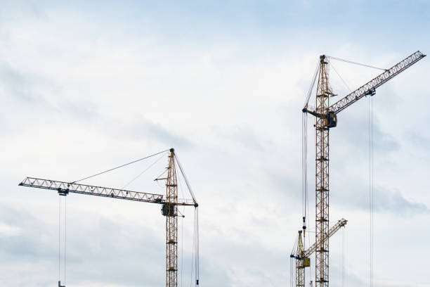 construction cranes construction of houses stock photo