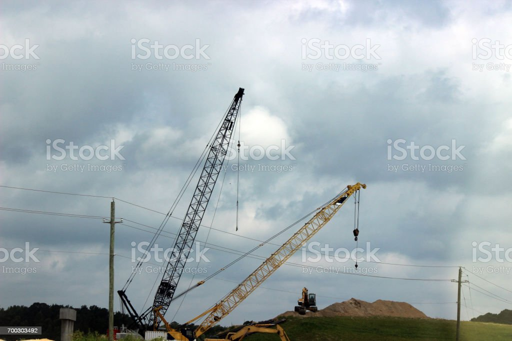 Construction Cranes on Highway Expansion Project stock photo