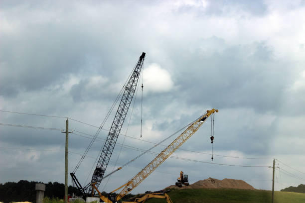 construction cranes on highway expansion project - pam schodt stock photos and pictures