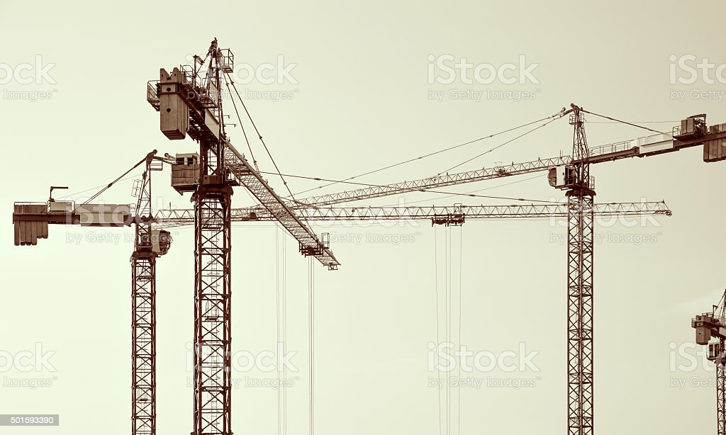 Construction cranes silhouettes. stock photo