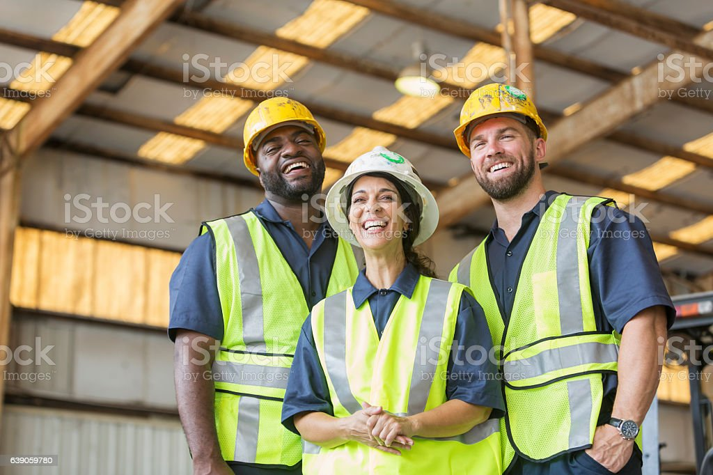Construction crew with female boss stock photo