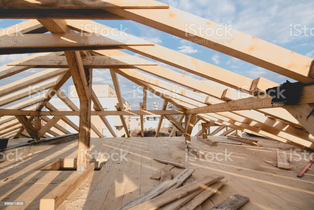 Construction details - framing installing the roof truss system stock photo