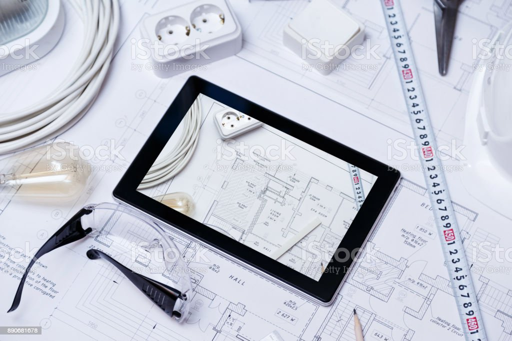 Construction drawing with tools and tablet stock photo