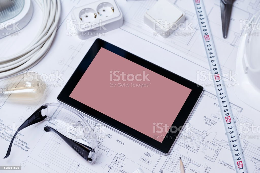 Construction drawing with tools and tablet with blank screen stock photo