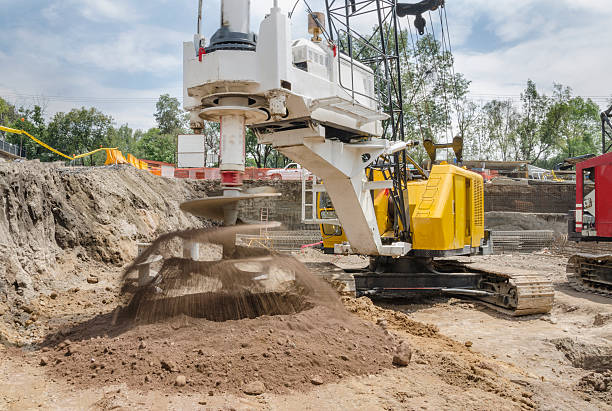 construction drilling machine with dirt auger - pillar drill stock photos and pictures