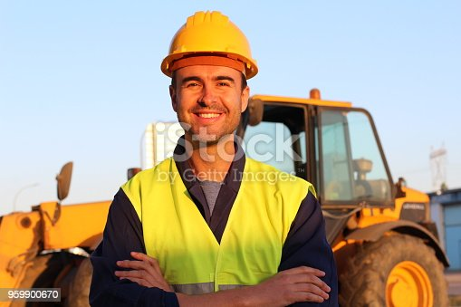 istock Construction driver with excavator on the background 959900670