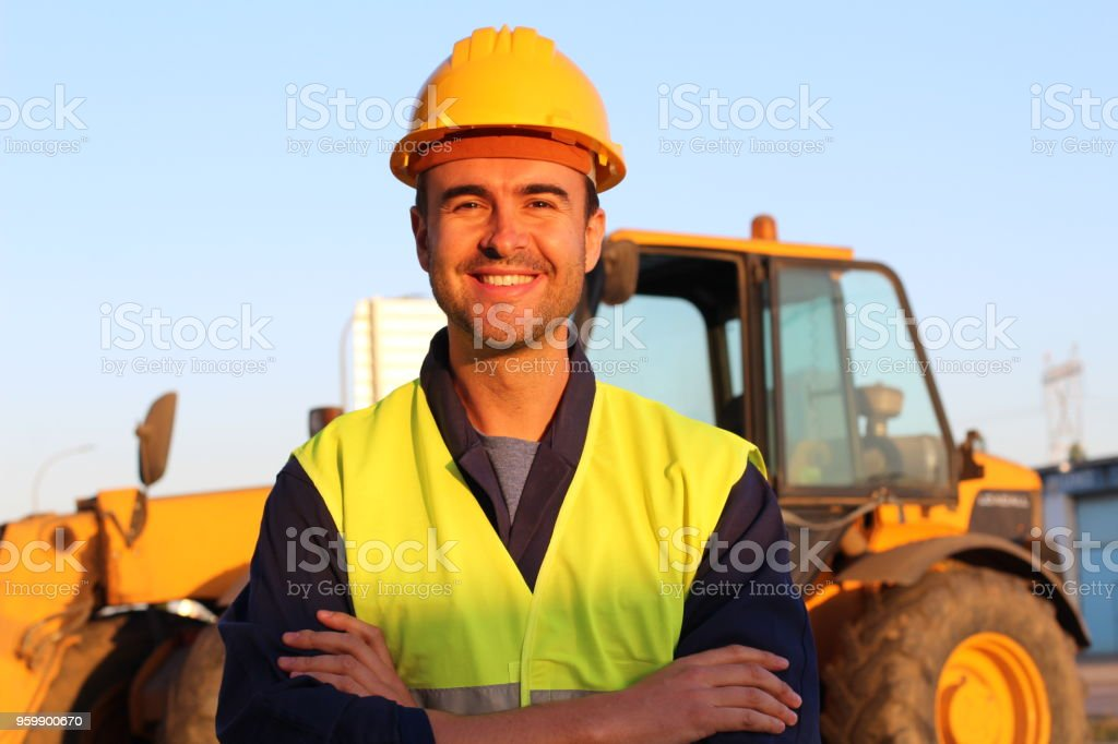 Construction driver with excavator on the background stock photo