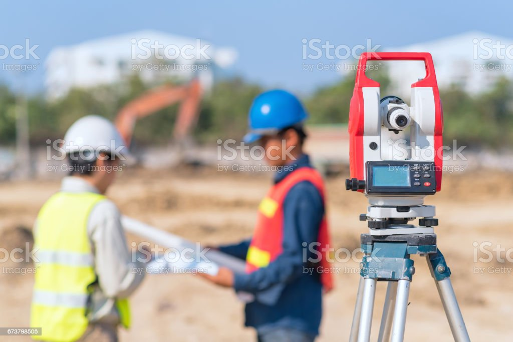 Construction engineer and foreman worker checking construction drawing at construction site royalty-free stock photo