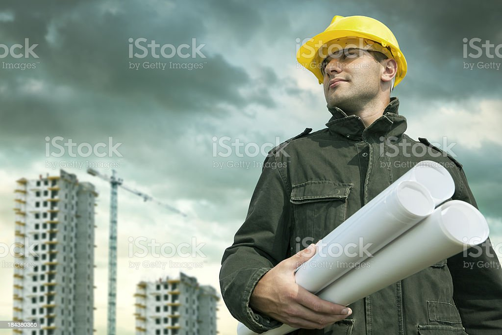 Construction engineer at a construction site with the plans. royalty-free stock photo