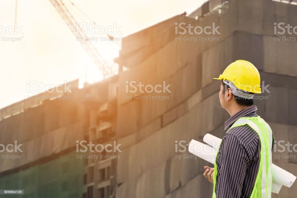 construction engineer at large condominium building site stock photo
