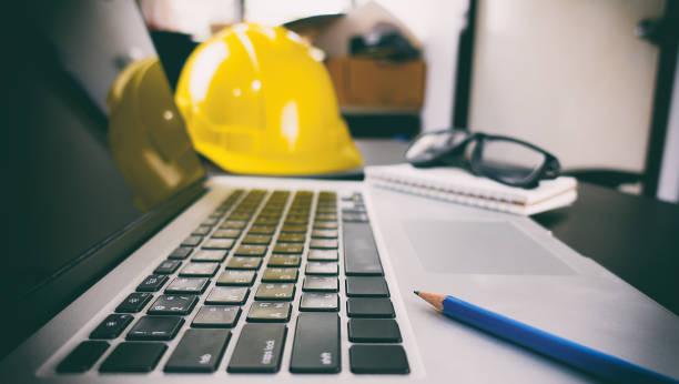 Construction Engineer Computer Laptop on office desk stock photo