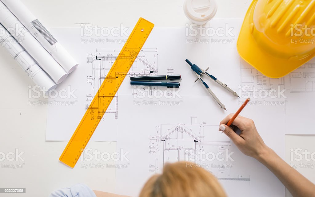Construction engineer drawing project stock photo