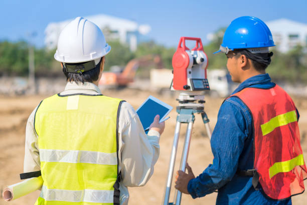 construction engineer hodling construction drawing and smart tablet with foreman worker - civil engineer stock photos and pictures
