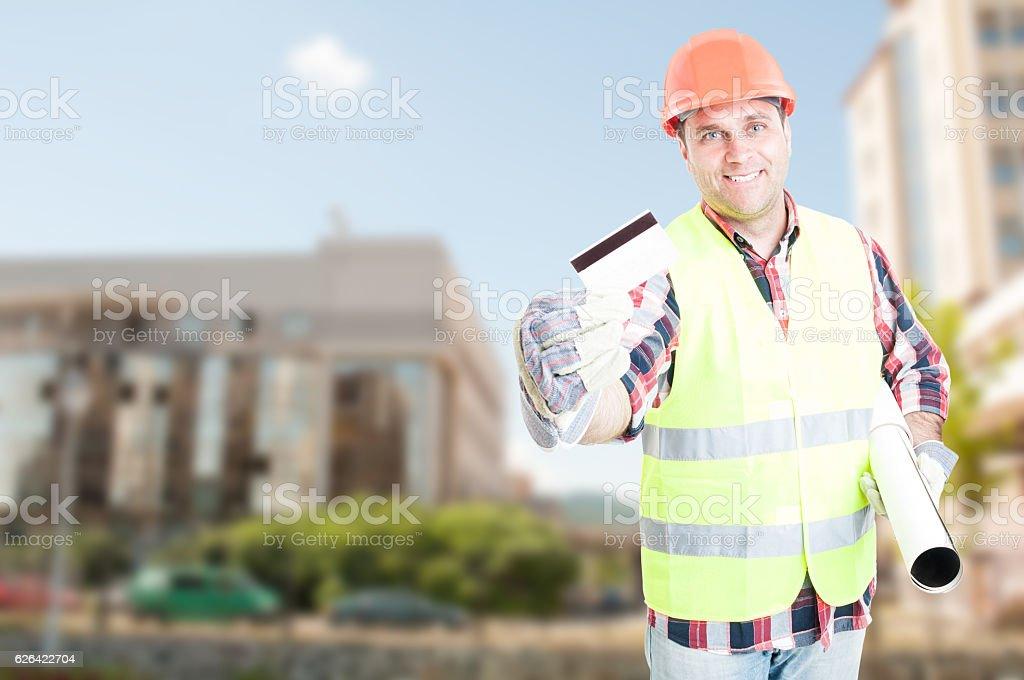 Construction engineer showing debit card stock photo