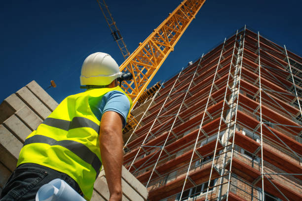 Construction engineer supervising building process stock photo