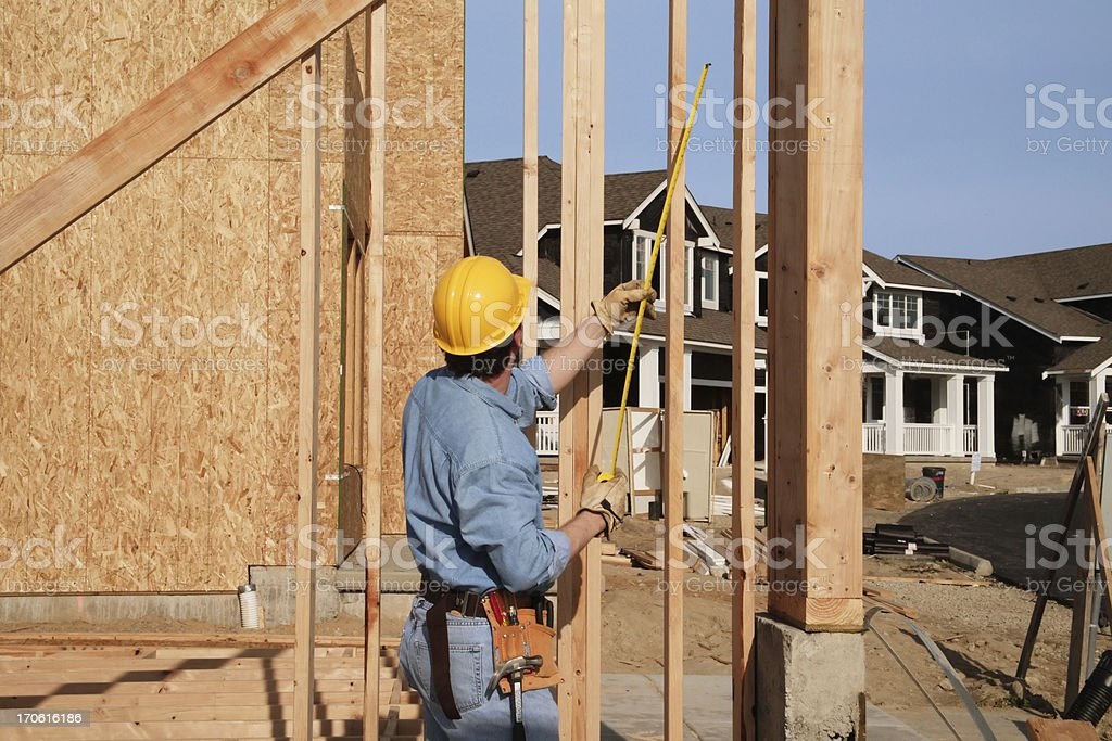 Construction engineer taking a measurement stock photo
