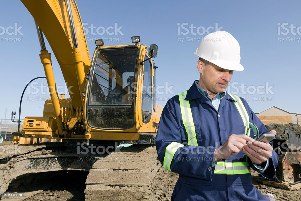 Construction Engineer Texting stock photo