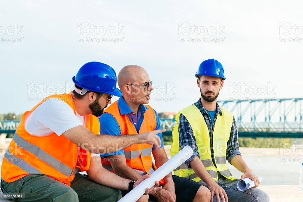 Construction engineers discussing about project final phase stock photo