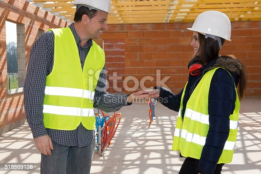 istock Construction Engineers holding hands to be agree 518869126