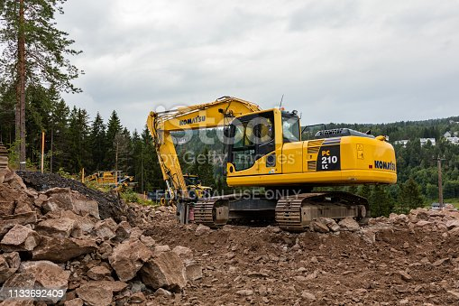 Construction equipment in Asker on a cloudy summer day. Asker is a municipality in Akershus county, Norway. It is part of the Greater Oslo Region. The administrative centre of the municipality is the town of Asker. The municipality was established as a municipality on 1 January 1838.
