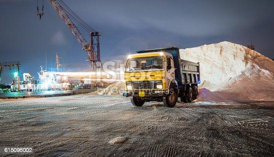 istock construction equipment on nightshift 615095002