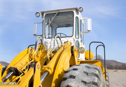 Heavy construction equipment ready for work. Close up of a front end loader.Please also see my lightbox: