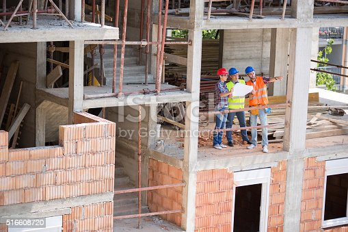 516607254 istock photo Construction experts on building construction discus about futur 516608720