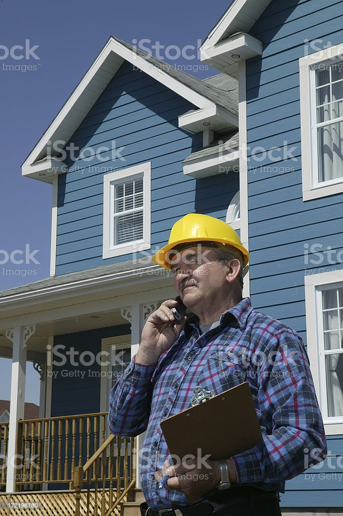 construction foreman over the phone royalty-free stock photo
