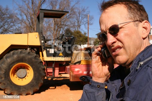 man talks on cell phone with bull dozer in backgroundI'd love to see how this is used. Thanks. :)