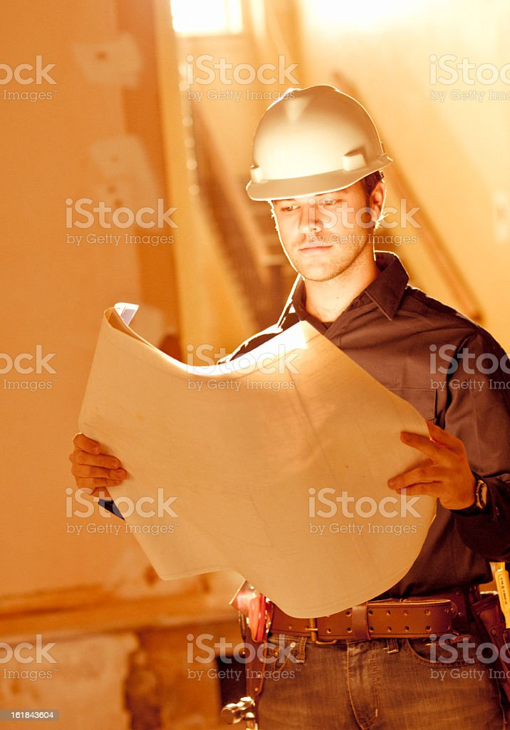 Construction Foreman reading plans royalty-free stock photo