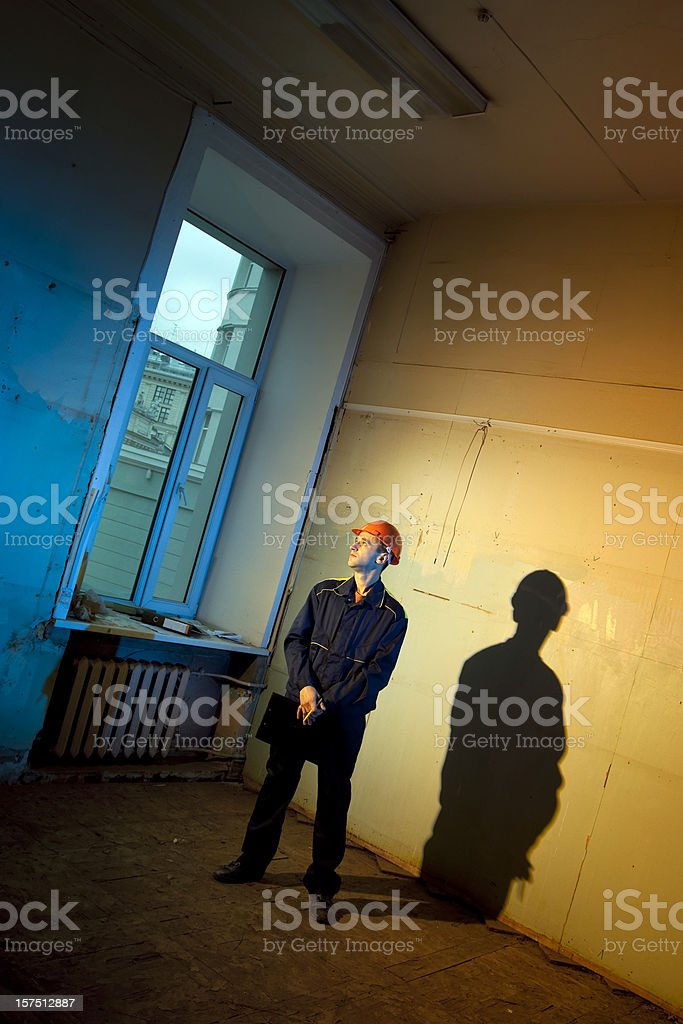 Construction foreman seeing round interior of old house royalty-free stock photo