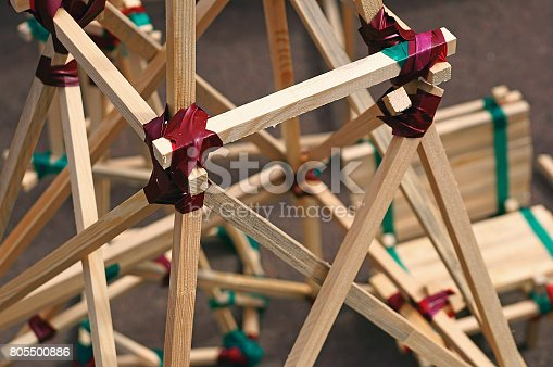 805500886 istock photo Construction from wooden slats connected by duct tape - architecture concept 805500886