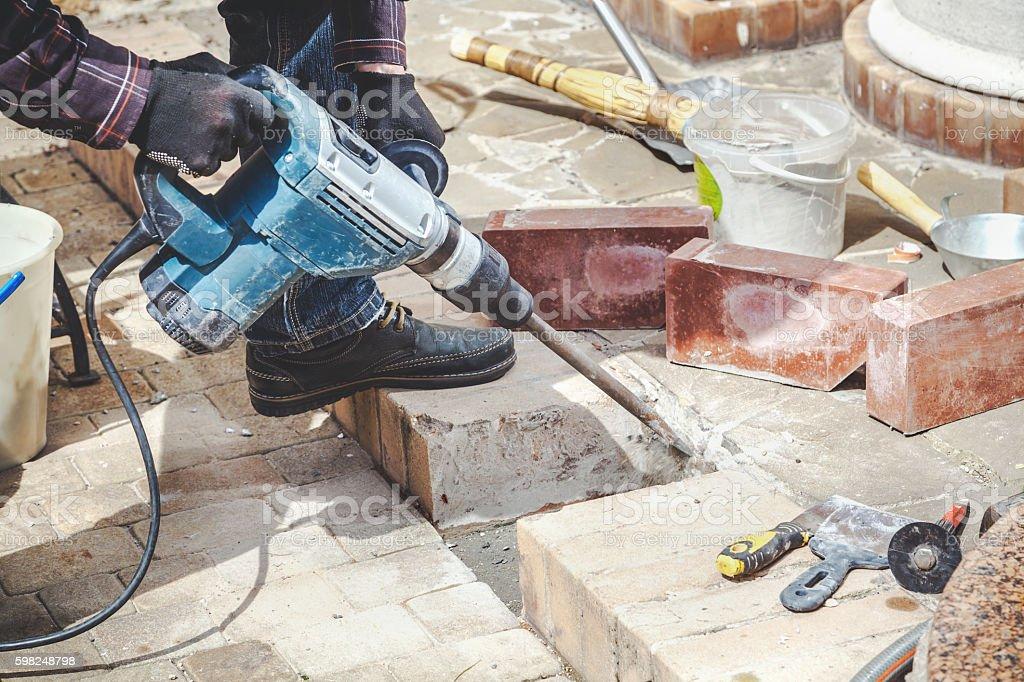 Construction Hammer destroying brickwork stock photo