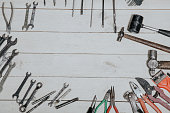 construction hammers screwdriver repair tool pliers on the white boards