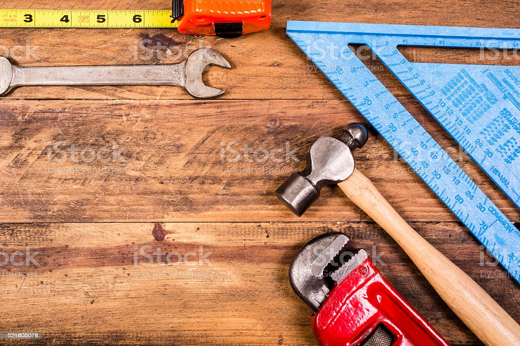 Construction hand tools on rustic wooden table.  Knolling. stock photo