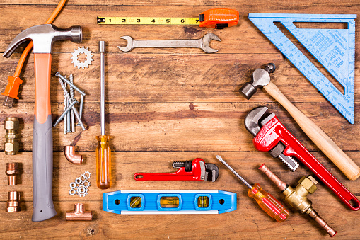 Construction hand tools on wooden table.  Knolling.