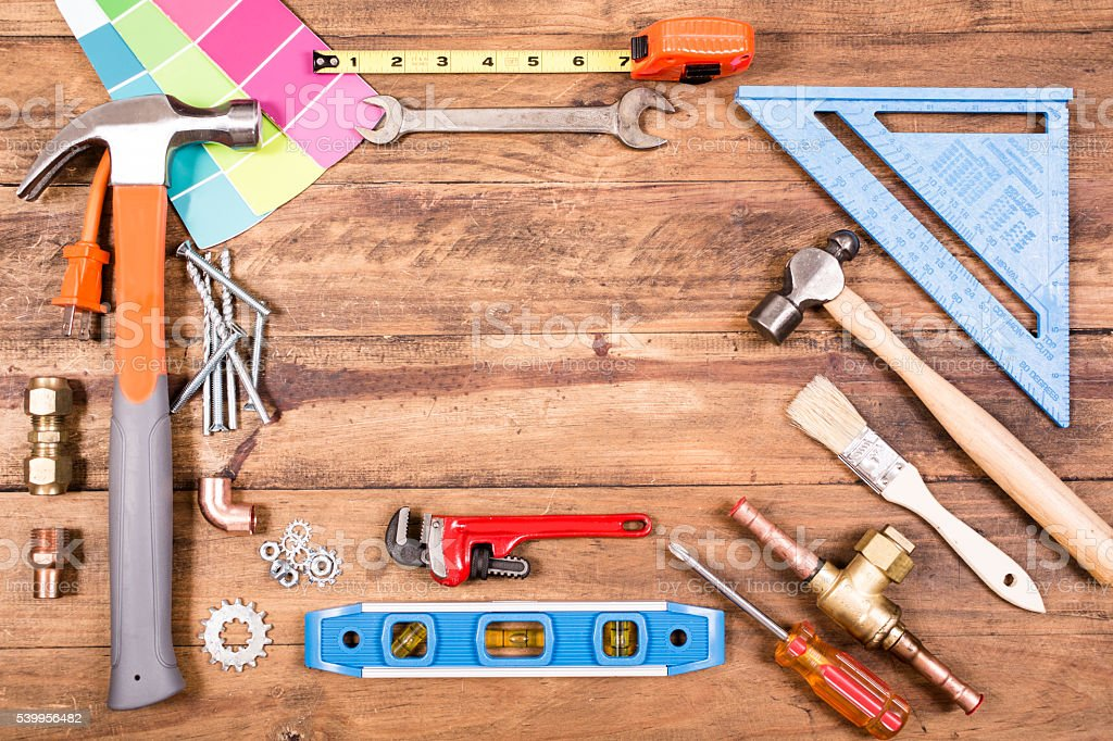 Construction hand tools on wooden table.  Knolling. stock photo