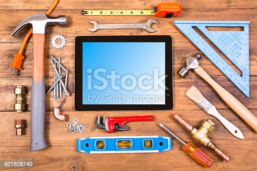 istock Construction hand tools surround a digital tablet.  Knolling. 521528740