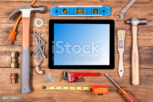 istock Construction hand tools surround a digital tablet. 531773012