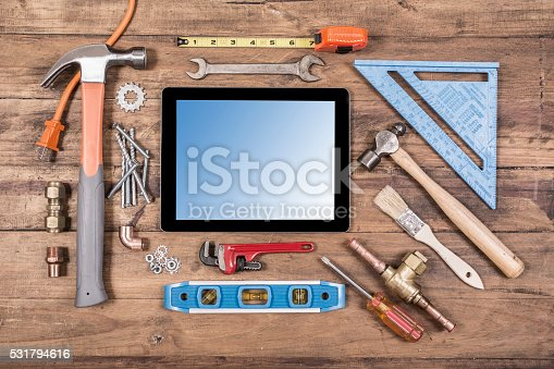 istock Construction hand tools surround a digital tablet. 531794616