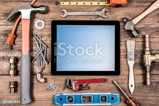 istock Construction hand tools surround a digital tablet. 531841944