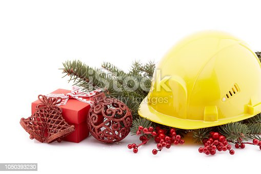 istock Construction hard hat and Christmas. 1050393230
