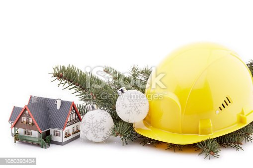 istock Construction hard hat and Christmas. 1050393434