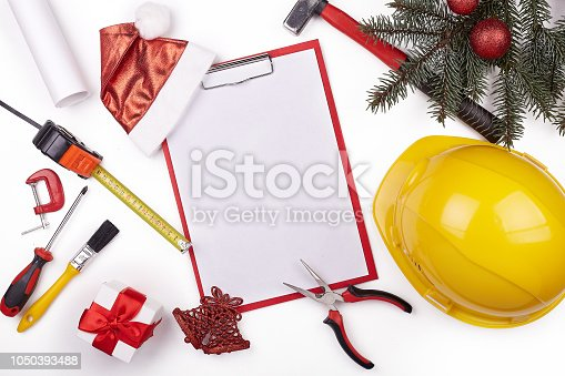 istock Construction hard hat and Christmas. 1050393488